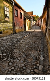 Stone paved street. Sighisoara Citadel is the old historic center of the town of Sighisoara, Romania, built in the 12th century by Saxon colonists. It is the last inhabited medieval citadel in Europe.