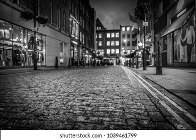 Stone Paved streets of London at night in black and white