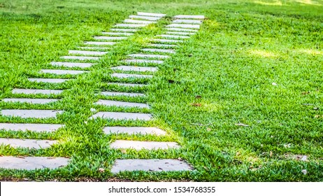 stone pavement curves.Stone pathway on green  grass .Summer season time for beginning life . moving forward . move on concept idea background . Garden decoration .