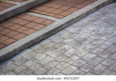 stone pavement in perspective. patterned paving tiles, cement brick floor background. Closeup on cement street floor. block brick background. Stairway. Stone blocks of a Brick Walkway, Stairway.