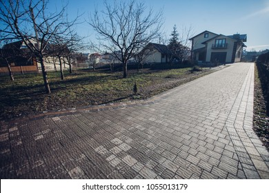 Stone pavement in perspective. Stone pavement texture. Granite cobblestoned pavement background. Abstract background of a cobblestone pavement close-u, home