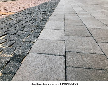 Stone pavement in perspective. Stone pavement texture. Granite cobblestoned pavement background. Abstract background of a cobblestone pavement