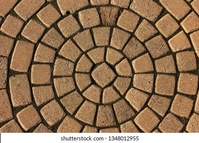 Stone pavement in perspective. Stone pavement texture. Granite cobblestoned pavement background. Abstract background of a cobblestone pavement close-up