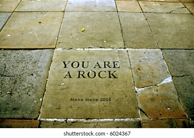 stone pavement and writing in Victoria Gardens, Leeds, Yorkshire