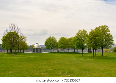 stone pavilion in park with trees green grass lawn hamilton ontario canada cloudy sky overcast big open space