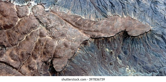 Stone penis ,abstract photography of the deserts of Africa from the air, bird's eye view, abstract expressionism, contemporary art, optical illusions,