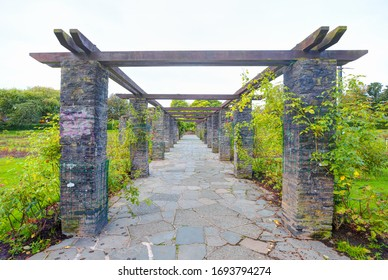 Stone perspective collumn alley-way pergola entrance with botanical garden in Belfast, Northern Ireland