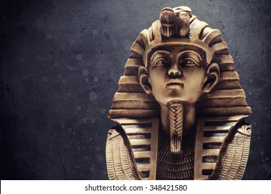 Stone pharaoh tutankhamen mask on dark background