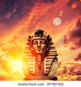 Stone pharaoh tutankhamen mask on sky background
