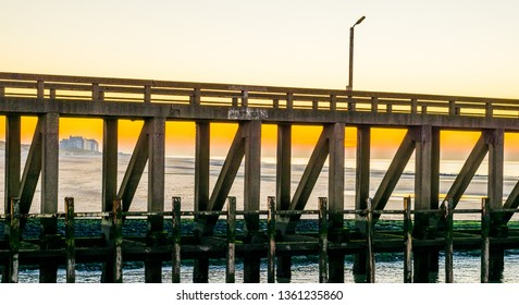 stone pier at the harbor of blankenberge, Belgium, architecture at the belgian coast