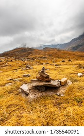 Stone pile in the middle of grassland on the top of the Timmelsjoch
