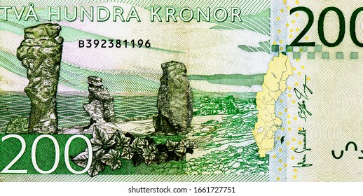 Stone pillars at Gotland, where Ingmar Bergman had his home, Portrait from Swedish 200 Kronor 2015 Banknotes. An Old paper banknote, vintage retro. Famous ancient Banknotes. Collection.