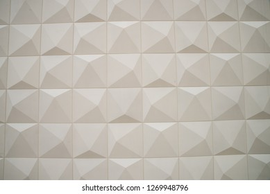 Stone with a pincushion pattern