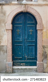Stone portal and a wooden door to the church