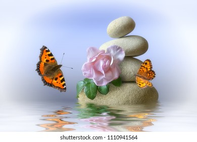 Stone pyramid with water and butterfly