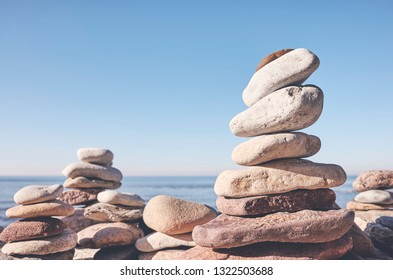 Stone pyramids  on a beach, balance and harmony concept, selective focus, color toning applied.