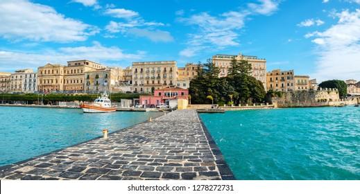 Stone quay and Ortigia Island. Syracuse, Sicily, Italy