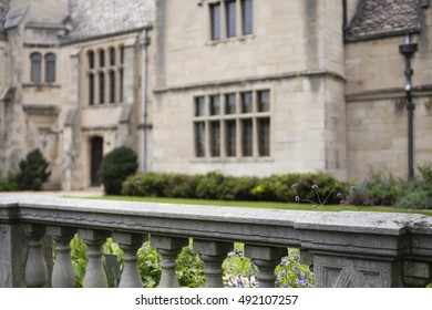 A stone railed in front of a garden at a historic mansion