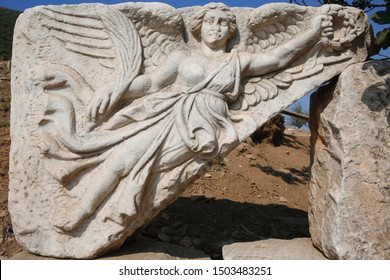 Stone relief of, the goddess of victory Nike in the ancient city of Ephesus.