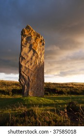 Stone of the Ring of Brodgar in dramatic evening light