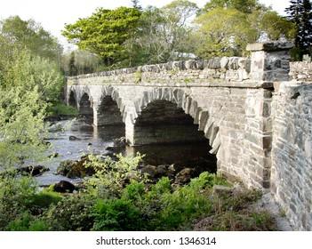 Stone road Bridge over river in Eire