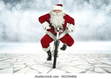 stone road and santa claus on bike