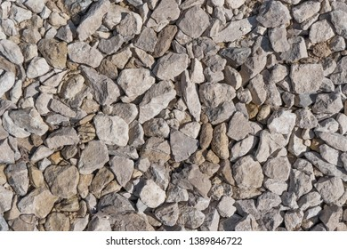 Stone rock background texture, gray stone road. Rubble, macadam background texture close up. Garden rubble road top view