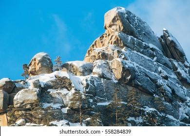Stone rock in snow. In Kazakhstan Natonal park Burabay (Borovoe)