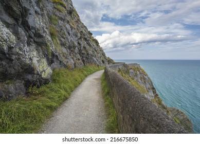 Stone rocks mountain path at Irish seacoast. Bray, Greystone