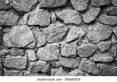 Stone rocks wall background. Black and white background of stone wall texture photo