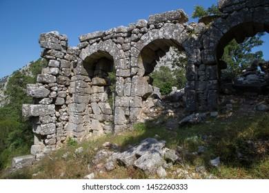 Stone ruins at ancient Anatolia city Thermessos, Antalya, Turkey.
