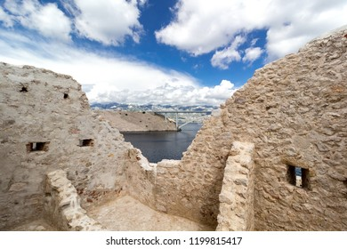 Stone ruins of fortress and the Pag bridge, Island of Pag, Croatia, Europe