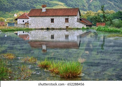 stone rural house reflection on waters springs, Montenegro