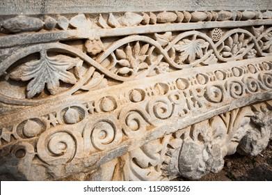 Stone rving in the ruins the Roman city of Gadara,  Umm Qais, Jordan
