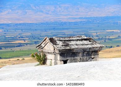 Stone sarcophagus in necropolis on travertine terraces, ancient Hierapolis, Pamukkale, Anatolia, Turkey. UNESCO world heritage site