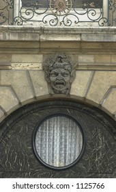 Stone sculpture above an archway of a building in Paris, France