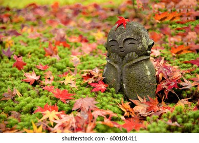 Stone sculpture dolls  and Maple Leaves at Momiji Autumn Leaves Festival at Enkoji Temple, Kyoto, Japan