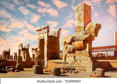 Stone sculpture of a horse in Persepolis against a blue and pink sky with clouds. Sunrise. The Victory symbol of the ancient Achaemenid Kingdom. Iran. Persia. Shiraz.