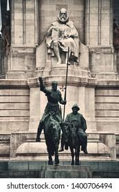 Stone sculpture of Miguel de Cervantes, Bronze sculptures of Don Quixote and Sancho Panza in Plaza de Espana in Madrid, Spain.