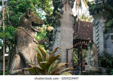 Stone sculpture of a wolf on the background of balinese temple, Bali, Indonesia