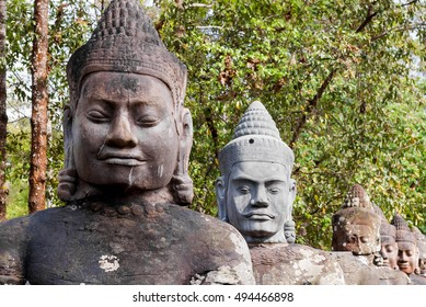 Stone sculptures near South Gate of Angkor Thom from outside the city. Angkor Wat. Siem Reap, Cambodia. UNESCO World Heritage Site.