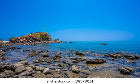 Stone Sea With Lighthouse Background