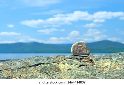 Stone and sea on nature summer background. pebble beach symbolizing stability, zen, relaxation, harmony, calm. vacation and travel concept. copy space