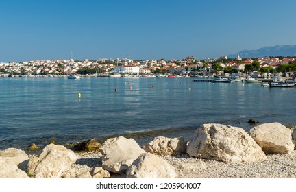 Stone shore in front of town of Novalja, landscape view, Croatia, Europe