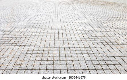 Stone sidewalk. Paving stones on roads and sidewalks in the old part of the city. Paving stone material background. Granite, cobblestone. Concrete paver floor template for background. - Shutterstock ID 1835446378
