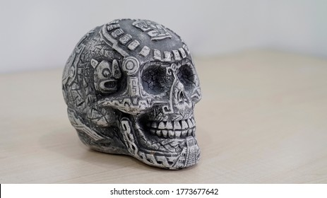 stone skull. traditional mexican skull. Day of the Dead. aztec skull. death. blurred background
