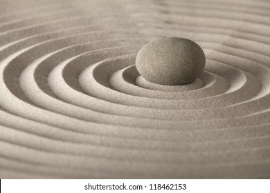 stone for spa relaxation or zen meditation concept for purity spirituality harmony and simplicity pattern in the sand