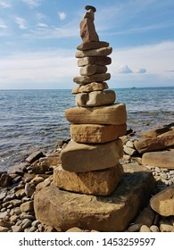 Stone stack made by people on the wild beach in Strunjan, Slovenia