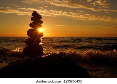 stone stack and sun
