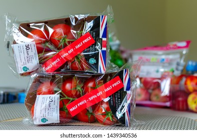 "Stone, Staffordshire / UK - July 1 2019: Pack of British Regal Vine Tomatoes with discount label from ALDI supermarket. Short dated vegetables on clearance are with label: ""Half price, 50% off"""